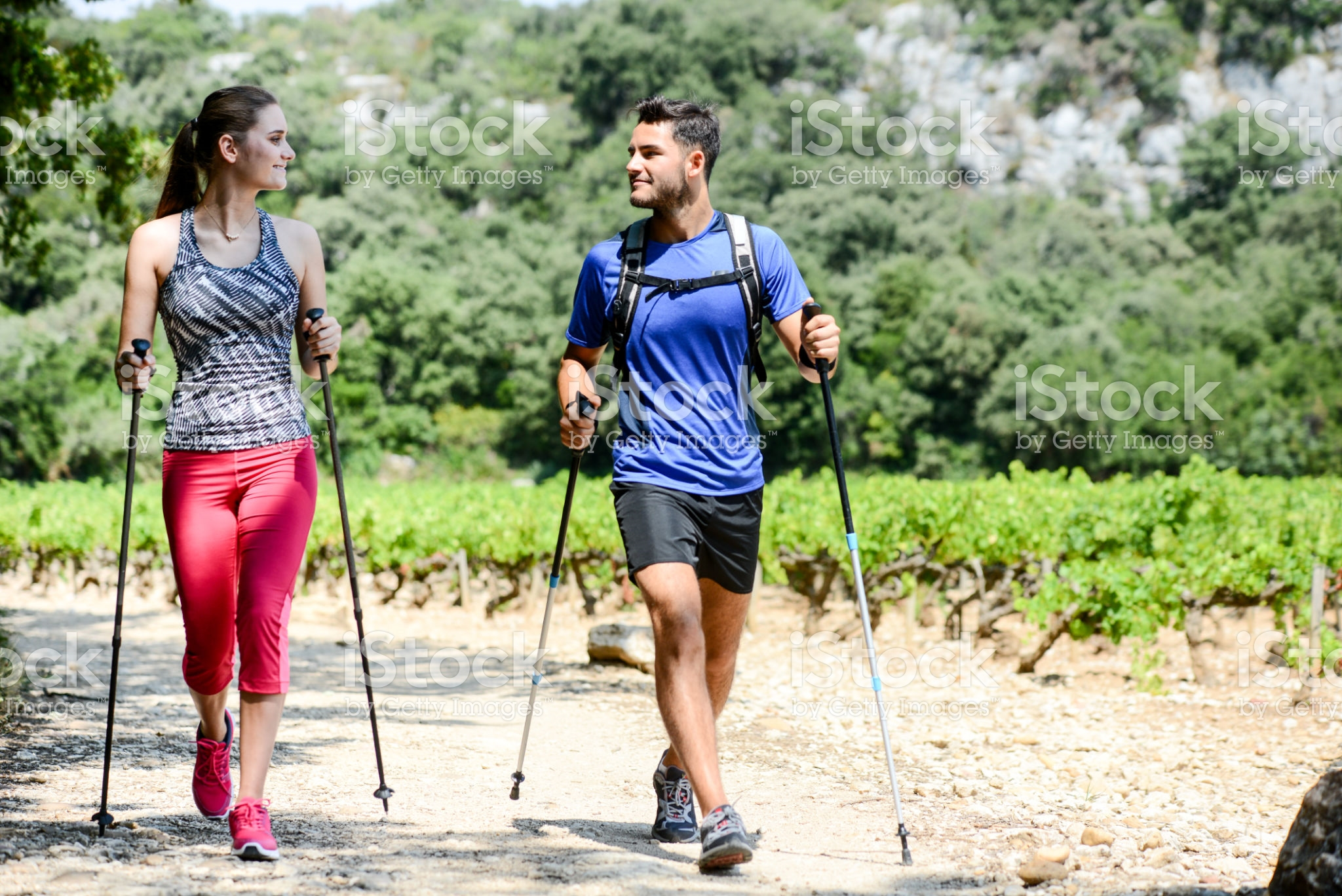 beautiful young couple sport fitness nordic walking and exercising together outdoor summer countryside forest